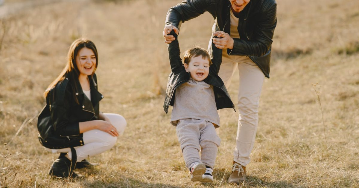 photo of family having fun with soccer ball